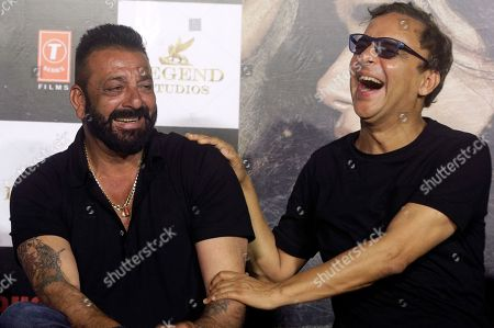 Sanjay Dutt, Vidhu Vinod Chopra Bollywood actor Sanjay Dutt, left, shares a light moment with Indian film director Vidhu Vinod Chopra, right, during the trailer launch of film Bhoomi in Mumbai, India, . The film is scheduled for release on September 22, 2017