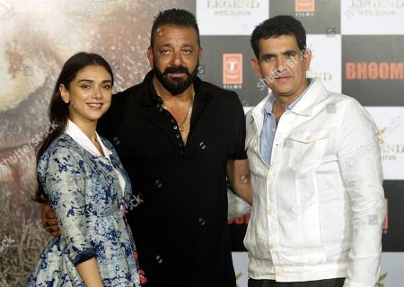 Aditi Rao Hydari, Sanjay Dutt, Omung Kumar Bollywood actors Aditi Rao Hydari, left, Sanjay Dutt, center, along with film director Omung Kumar pose during the trailer launch of film Bhoomi in Mumbai, India, . The film is scheduled for release on September 22, 2017