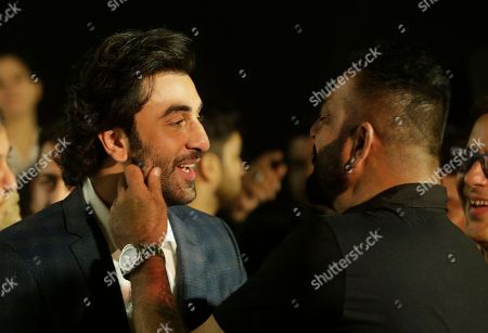 Ranbir Kapoor, Sanjay Dutt Bollywood actors Ranbir Kapoor, left and Sanjay Dutt speak as they arrive for the trailer launch of film Bhoomi in Mumbai, India, . The film is scheduled for release on September 22, 2017