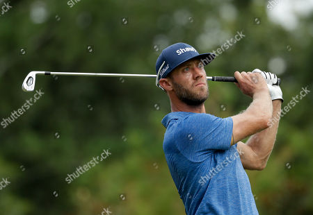 Graham DeLaet watches his tee shot on the sixth hole during the first round of the PGA Championship golf tournament at the Quail Hollow Club, in Charlotte, N.C