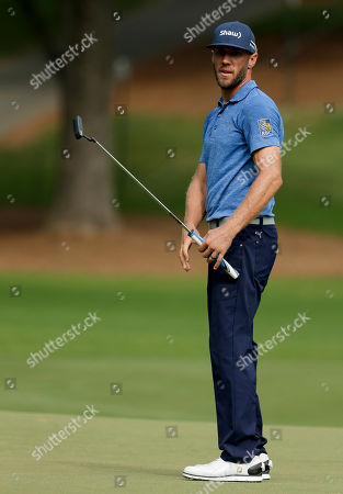 Graham DeLaet watches his putt on the sixth hole during the first round of the PGA Championship golf tournament at the Quail Hollow Club, in Charlotte, N.C