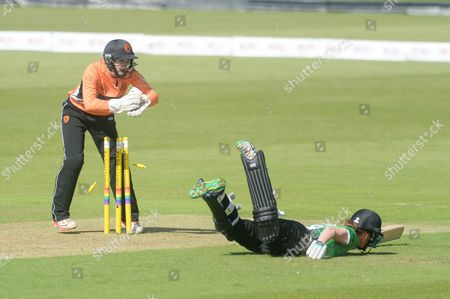 Carla Rudd of Southern Vipers takes off the bails as Jodie dibble is Run out by Arran Brindle during the Women's Cricket Super League match between Southern Vipers and Western Storm at the Ageas Bowl, Southampton