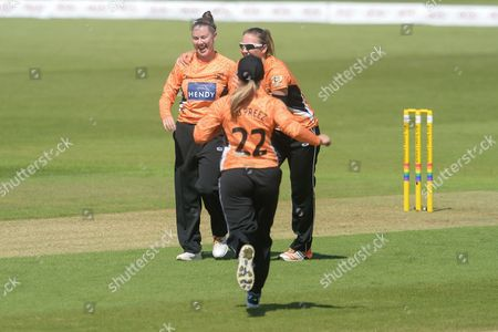 Stock Photo of Linsey Smith Katie George and Mignon du Preez celebrate the wicket of Heather Knightof Southern Vipers  during the Women's Cricket Super League match between Southern Vipers and Western Storm at the Ageas Bowl, Southampton