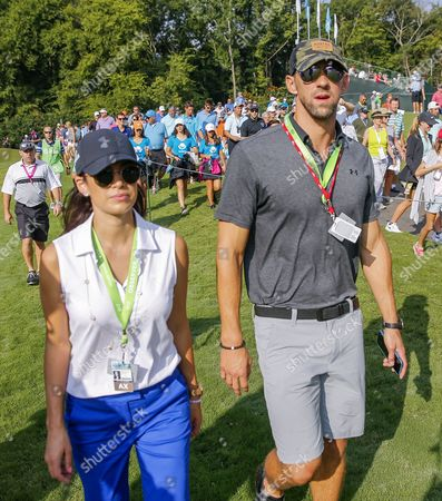 US gold medal swimmer Michael Phelps (R) and his wife Nicole Johnson (L) walk with the golfing trio of Jordan Spieth, Brooks Koepka and Sergio Garcia at the twelfth hole during the first round of the 99th PGA Championship golf tournament at Quail Hollow Club in Charlotte, North Carolina, USA, 10 August 2017.