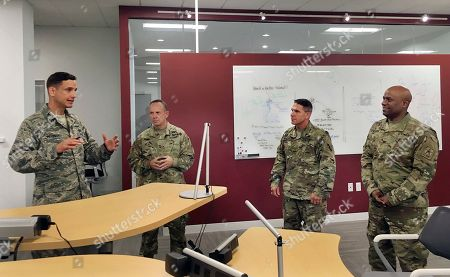 Col. Michael McGinley, left, gives a tour of the U.S. Defense Department's Defense Innovation Unit Experimental office in Cambridge, Mass., which he oversees. Visiting the office are Maj. Gen. James Young Jr., second from left, of the Army Reserve's 75th Training Command in Houston, and Army Reserve Chief Warrant Officer Pat Nelligan, second from right, who hails from Bristol, Conn. Col. Joseph D'costa, far right, also works at the DIUx office. DIUx works with contractors to fund and develop solutions for the military's toughest technology challenges