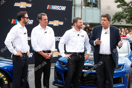 Mike Helton, NASCAR vice chairman, from right, speaks as driver Dale Earnhardt Jr., Mark Reuss, Executive Vice President, Global Product Development, General Motors Company; and driver Jimmie Johnson listen to the introduction of the 2018 Chevrolet Camaro ZL1 as a new race car for the Monster Energy NASCAR Cup Series during a news conference in Detroit, . The new Camaro will make its on-track debut during the 2018 Daytona 500
