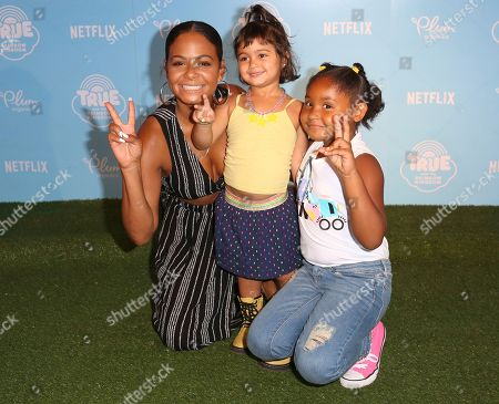 """Christina Milian, Violet Madison Nash Christina Milian, from left, guest and daughter Violet Madison Nash arrive at the Special Screening of """"True and the Rainbow Kingdom"""" at The Grove, in Los Angeles"""
