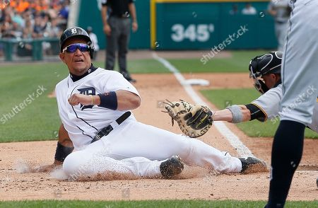 Miguel Cabrera, Chris Stewart Detroit Tigers' Miguel Cabrera, left, beats the tag from Pittsburgh Pirates catcher Chris Stewart to score from first base on a triple by Nicholas Castellanos during the first inning of an interleague baseball game, in Detroit