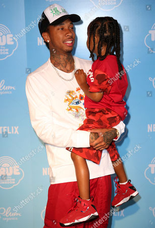 """Tyga, King Cairo Stevenson Tyga, left, and son King Cairo Stevenson arrive at the Special Screening of """"True and the Rainbow Kingdom"""" at The Grove, in West Hollywood, Calif"""