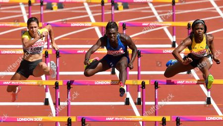 Germany's Ricarda Lobe, United States' Dawn Harper Nelson and Jamaica's Rushelle Burton, from left, compete in a women's 100m hurdles first round heat during the World Athletics Championships in London