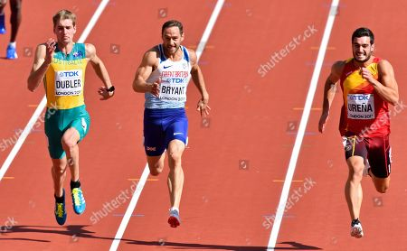 Australia's Cedric Dubler, Britain's Ashley Bryant and Spain's Jorge Urena, from left, compete in the 100m event of the decathlon during the World Athletics Championships in London