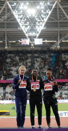 Russia's Darya Klishina, left, silver, United States' Brittney Reese, gold, and United States' Tianna Bartoletta, bronze, smile during the medal ceremony for the Women's long jump during the World Athletics Championships in London