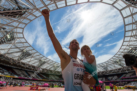 Stock Picture of Robbie Grabarz of Great Britain celebrates with his daughter Lyra after the Men's High Jump qualification