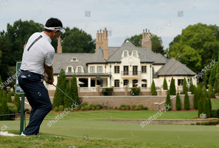 Stock Picture of Y. E. Yang of South Korea, chips to the seventh green during the second round of the PGA Championship golf tournament at the Quail Hollow Club, in Charlotte, N.C