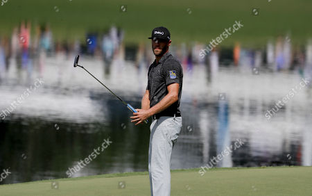 Graham Delaet watches his putt on the 14th hole during the second round of the PGA Championship golf tournament at the Quail Hollow Club, in Charlotte, N.C