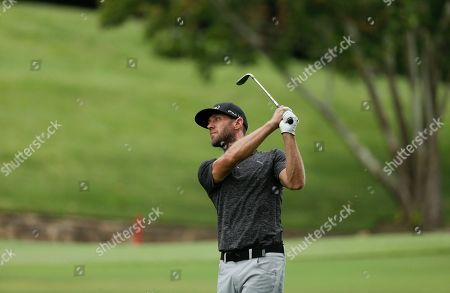 Graham DeLaet hits from the fairway on the seventh hole during the second round of the PGA Championship golf tournament at the Quail Hollow Club, in Charlotte, N.C