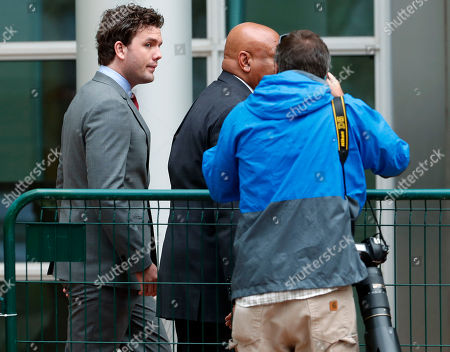 Austin Swift, left, follows a bodyguard into the federal courthouse to attend the morning session in the civil trial for his sister, pop singer Taylor Swift, in Denver. Radio station DJ David Mueller sued Swift after her team reported she was groped by Mueller to his bosses at a country music station. He is seeking up to $3 million, saying the allegation cost him his job and reputation. Swift countersued Mueller, claiming sexual assault. She is seeking a symbolic $1