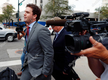 Austin Swift, brother of pop singer Taylor Swift, heads to a hotel after emerging from the federal courthouse following a ruling in the civil trial for Taylor Swift to determine whether a Denver radio announcer groped the singer in a case in federal court late, in Denver. A judge on Friday threw out a former radio host's case against Taylor Swift in a trial that delved into their dueling lawsuits over whether he groped her during a backstage meet-and-greet and whether she and her team ruined his career