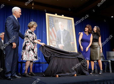 Stock Photo of Vice President Mike Pence watches as his mother, Nancy Pence-Fritsch and wife, Karen, unveil of his official state portrait, in Indianapolis. Pence's daughter, Audrey Pence is at right