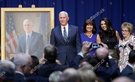 Vice President Mike Pence poses for a photo with is family, mother Nancy Pence-Fritsch, right, Karen Pence and Audrey Pence after the unveiling of his official state portrait, in Indianapolis