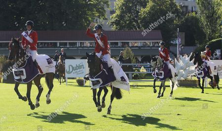 Stock Picture of USA's Laura Kraut, Lillie Keenan, Lauren Hough and Beezie Madden celebrate winning the Nations Cup