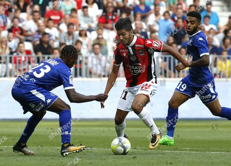 Bassem Srarfi of OGC Nice (C) vies for the ball with Charles Traore of Estac Troyes (L) during the French Ligue 1 soccer match, OGC Nice vs Estac Troyes , at the Allianz Riviera stadium, in Nice, France, 11 August 2017.