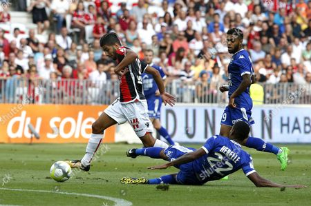 Bassem Srarfi of OGC Nice (L) vies for the ball with Christophe Herelle of Estac Troyes (R, bottom) during the French Ligue 1 soccer match, OGC Nice vs Estac Troyes , at the Allianz Riviera stadium, in Nice, France, 11 August 2017.