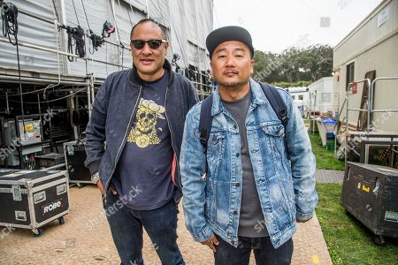 Stock Image of Dan the Automator, Dan Nakamura, Roy Choi Dan the Automator, left, of Dr. Octagon poses with Roy Choi at 2017 Outside Lands Music Festival at Golden Gate Park, in San Francisco, Calif