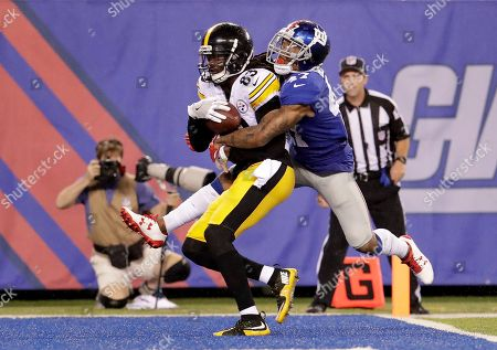 Pittsburgh Steelers wide receiver Cobi Hamilton (83) scores a touchdown against New York Giants defensive back Valentino Blake (47) during the second quarter of a preseason NFL football game, in East Rutherford, N.J