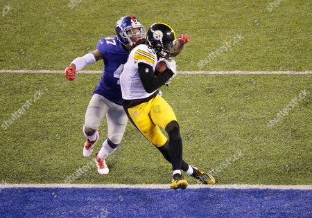 Pittsburgh Steelers wide receiver Cobi Hamilton (83) catches a pass for a touchdown against New York Giants defensive back Valentino Blake (47) during the second quarter of a preseason NFL football game, in East Rutherford, N.J