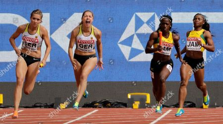 Germany's Rebekka Haase, left, takes the baton to run the anchor leg in a Women's 4x100m relay heat during the World Athletics Championships in London