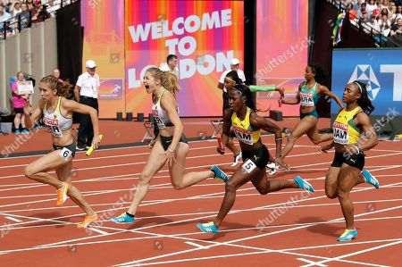 From left, Germany's Rebekka Haase and Gina Lueckenkemper and Jamaica's Sashalee Forbes and Jura Levy exchange the baton in a women's 4x100-meter first round heat at the World Athletics Championships in London