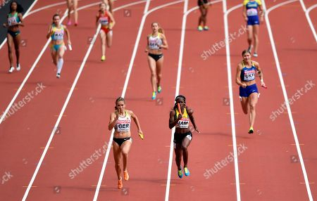 Germany's Rebekka Haase, center left, anchors the German team to win a Women's 4x100m relay heat during the World Athletics Championships in London