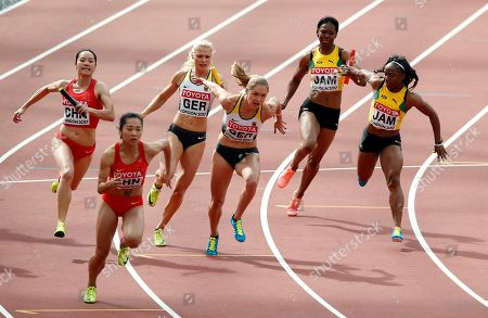 Stock Picture of China's Wei Yongli, left, tries to pass the baton to Ge Manqi in a women's 4x100-meter relay first round heat during the World Athletics Championships in London . Others are, from left, Germany's Lisa Mayer and Gina Lueckenkemper and Jamaica's Natasha Morrison and Jura Levy