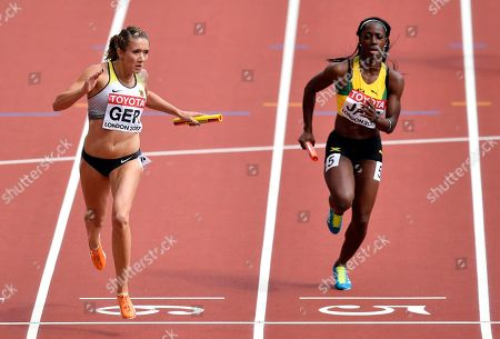 Germany's Rebekka Haase, left, crosses the line to win a Women's 4x100m relay heat during the World Athletics Championships in London