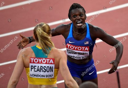 Women's 100 meters hurdles final silver medalist United States' Dawn Harper Nelson looks to embrace and congratulate gold medalist Australia's Sally Pearson, left, at the World Athletics Championships in London