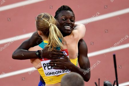 Women's 100 meters hurdles final silver medalist United States' Dawn Harper Nelson embraces gold medalist Australia's Sally Pearson, left, at the World Athletics Championships in London