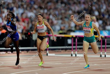 Australia's Sally Pearson, right, crosses the finish line to win the women's 100 m hurdles race ahead of United States' Dawn Harper Nelson, who won silver, left, and Germany's Pamela Dutkiewicz, who was third during the World Athletics Championships in London