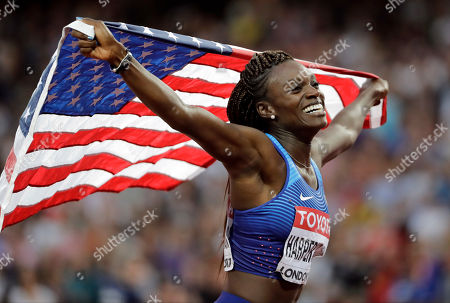 United States' Dawn Harper Nelson celebrates winning the silver medal in the final of the Women's 100m hurdles during the World Athletics Championships in London