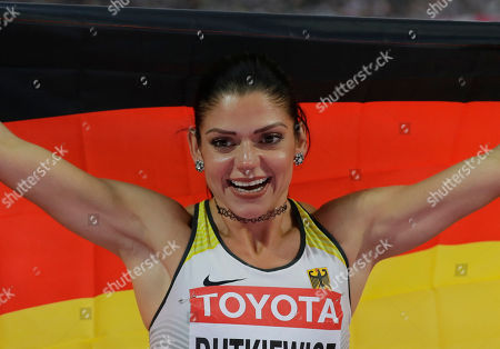 Germany's Pamela Dutkiewicz reacts after winning bronze in the women's 100 m hurdles race during the World Athletics Championships in London
