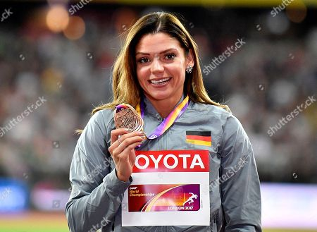 Germany's Pamela Dutkiewicz holds her bronze medal on the podium for the Women's 100 meters hurdles at during the World Athletics Championships in London