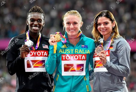 Women's 100 meters hurdles gold medalist Australia's Sally Pearson, centre, stands with silver medalist United States' Dawn Harper Nelson, left, and bronze medalist Germany's Pamela Dutkiewicz, right, on the podium at the World Athletics Championships in London
