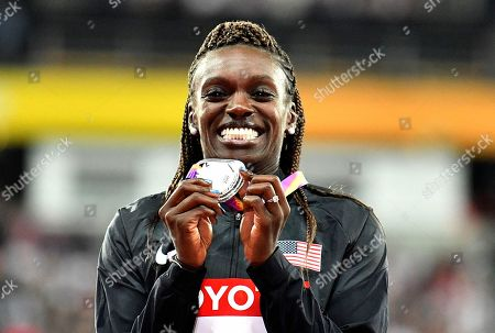 Women's 100 meters hurdles silver medalist United States' Dawn Harper Nelson celebrates on the podium at the World Athletics Championships in London