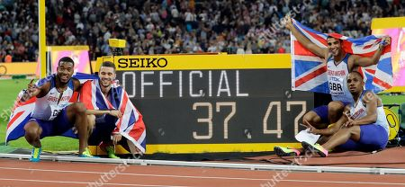 Stock Photo of Britain's Nethaneel Mitchell-Blake, Daniel Talbot, Chijindu Ujah and Adam Gemili celebrate after winning the gold medal in the Men's 4x100m relay during the World Athletics Championships in London
