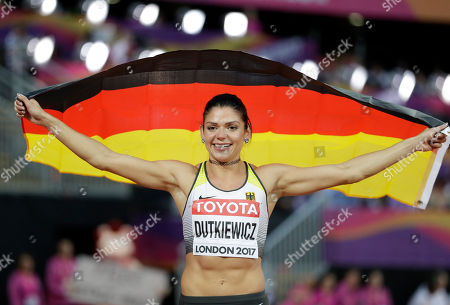 Germany's Pamela Dutkiewicz celebrates after winning the bronze medal in the women's 100-meter hurdles final during the World Athletics Championships in London