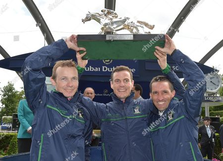 (L) Jamie Spencer, Captain, (C) Fran Berry and (R) Neil Callan, the winning jockeys team representing Great Britain and Ireland hold The Shergar Cup aloft.