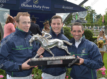 Stock Image of (L) Jamie Spencer, Captain, (C) Fran Berry and (R) Neil Callan, the winning jockeys team representing Great Britain and Ireland hold The Shergar Cup aloft.