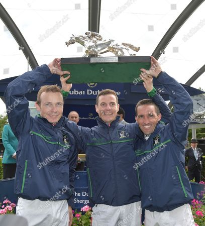 Stock Photo of (L) Jamie Spencer, Captain, (C) Fran Berry and (R) Neil Callan, the winning jockeys team representing Great Britain and Ireland hold The Shergar Cup aloft.