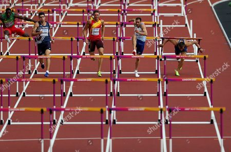 Stock Picture of Ashley Bryant of Great Britain as Mihail Dudas of Serbia falls during the Decathlon Men's 100 meters Hurdles heats