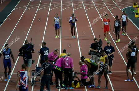 Adam Gemini celebrates with Desiree Henry of Great Britain after winning Gold as Usain Bolt of Jamaica pulls up injured during the Men's 4x100 meters relay finals